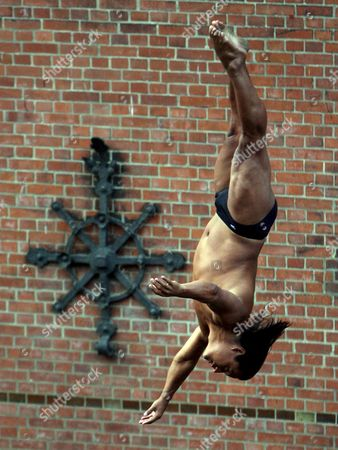 Stock Picture of Colombian Cliff Diver Jose Eber Pava Ordonez Takes a Dive During One of His Shows in Speicherstadt Hamburg Germany 19 August 2008 the 'Red Bull Cliff Diving' the Tour of the Hamburg Port Area with the 10 Best Cliff Divers in the World Takes Place From 19 to 23 August Germany Hamburg
