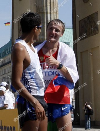 Valeriy Borchin of Russia (r) Celebrates with Eder Sanchez of Mexico in the Walk 20km Men at the 12th Iaaf World Championships in Athletics Berlin Germany 15 August 2009 Germany Berlin