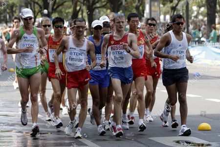 Stock Picture of The Athletes Compete with Valeriy Borchin of Russia (c) and Eder Sanchez (r) of Mexico in the Walk 20km Men at the 12th Iaaf World Championships in Athletics Berlin Germany 15 August 2009 Germany Berlin