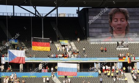 The German (c) Flag is Hoisted and the National Anthem Played For Javelin Gold Medal Winner Steffi Nerius (right on Screen) of Germany During the Medal Ceremony For the Women's Javelin Throw at the 12th Iaaf World Championships in Athletics Berlin Germany 19 August 2009 Silver Medalist was Barbora Spotakova of the Czech Republic and Bronze Medal Winner Maria Abakumova of Russia Germany Berlin