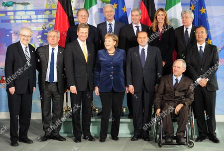 Members of the German and Italian Government Pose For a Group Photo at the Chancellery in Berlin Germany 12 January 2011 From L-r at Front German Minister of Economy Rainer Bruederle Italian Finance Minister Giulio Tremonti German Foreign Minister Guido Westerwelle German Chancellor Angela Merkel Italian Prime Minister Silvio Berlusconi German Finance Minister Wolfgang Schaeuble and Italian Foreign Minister Franco Frattini in the Back Row From L-r Italian Minister of Transport Altero Matteoli German Minister of Transport Peter Ramsauer German Environment Minister Norbert Roettgen Italian Environment Minister Stefania Prestigiacomo and Italian Minister of Transport Paolo Romani Germany and Italy Urged the European Union to Step Up Efforts to Safeguard Religious Freedom and Protect Religious Minorities Targeted by Recent Attacks in Predominantly Muslim Countries Germany Berlin