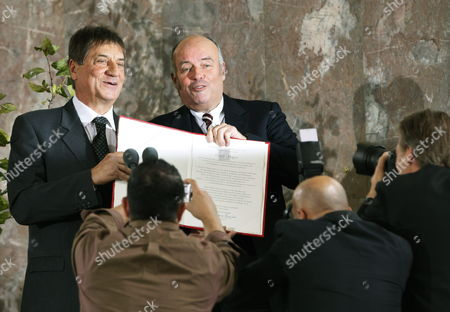 Italian Author Claudio Magris (l) Poses For Mphotos After Being Awarded at the Paulskirche Church in Frankfurt Am Main with the Peace Prize of the German Book Association by Gottfried Honnefelder (r) Principal of the Association 18 October 2009 the Author and Germanic is Honored For His Literary Efforts on Coexistence and Cooperation of Different Cultures in Europe the Prize is Valued at 25000 Euros Germany Frankfurt/main