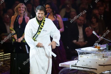 Stock Photo of Austrian Singer Udo Jurgens Performs in the Westfalenhalle in Dortmund Germany 19 December 2009 Soccer Club Borussia Dortmund Celebrated Their 100th Anniversary with a Big Show Germany Dortmund