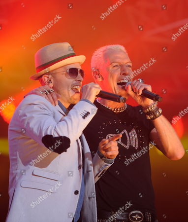 H P Baxxter (r) Singer of German Dance Music Band Scooter and Guest Singer German Jan Delay (l) Perform During a Scooter Concert in Hamburg Germany on 25 June 2011 the Concert Entitled 'Stadium Techno Inferno' was Broadcast in Several Cinemas Throughout Germany Germany Hamburg