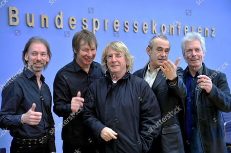 Stock Picture of Musicians Matt Letley (l-r) John Edwards Rick Parfitt Francis Rossi and Andy Bown of British Rock Band 'Status Quo' Pose For Photographers at the Auditorium of the 'Bundespressekonferenz' in Berlin Germany 10 November 2008 the Band Will 'Rock' the 57th 'Bundespresseball' ('german Media Ball') to Take Place on 28 November 2008 in Berlin Germany Berlin