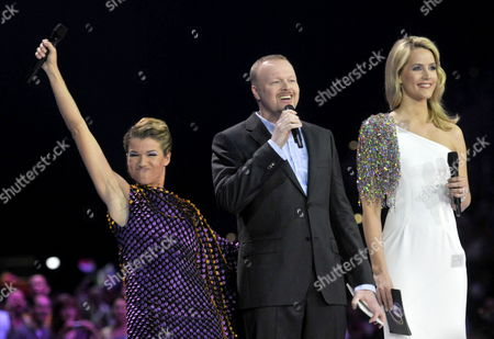 From (l-r) German Hosts Anke Engelke Stefan Raab and Judith Rakers Hosts of the Eurovision Song Contest 2011 React on Stage During the First Semi-final of the Eurovision Song Contest in Duesseldorf Germany 10 May 2011 the Final of the 56th Eurovision Song Contest Takes Place on 14 May 2011 Germany Duesseldorf