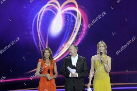 From (l-r): German Hosts of the Eurovision Song Contest 2011 Anke Engelke Stefan Raab and Judith Rakers Are Pictured on Stage During the First Dress Rehearsal For the Second Semi-final of the Eurovision Song Contest in Duesseldorf Germany 11 May 2011 the Final of the 56th Eurovision Song Contest Takes Place on 14 May 2011 in Duesseldorf Germany Duesseldorf