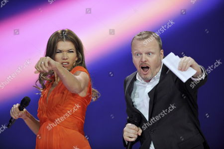 German Hosts of the Eurovision Song Contest 2011 Anke Engelke (l) and Stefan Raab Gesture on Stage During the First Dress Rehearsal For the Second Semi-final of the Eurovision Song Contest in Duesseldorf Germany 11 May 2011 the Final of the 56th Eurovision Song Contest Takes Place on 14 May 2011 in Duesseldorf Germany Duesseldorf