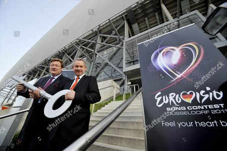 Epa02673544 the Mayor of Duesseldorf Dirk Elbers (l) and Director of the German Broadcaster Norddeustcher Rundfunk Ndr (north German Broadcasting) Are Pictured During the Symbolic Handing Over of the Key to the Esprit Arena to the Broadcaster Ndr in Duesseldorf Germany 07 April 2011 the Finals of the Eurovision Song Contest Take Place at the Arena on 14 May 2011 Epa/henning Kaiser Germany Duesseldorf
