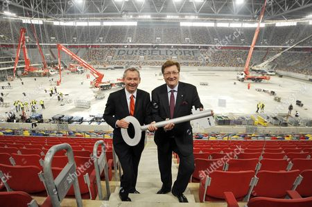 Stock Photo of The Mayor of Duesseldorf Dirk Elbers (l) and Director of the German Broadcaster Norddeustcher Rundfunk Ndr (north German Broadcasting) Are Pictured During the Symbolic Handing Over of the Key to the Esprit Arena to the Broadcaster Ndr in Duesseldorf Germany 07 April 2011 the Finals of the Eurovision Song Contest Take Place at the Arena on 14 May 2011 Germany Duesseldorf