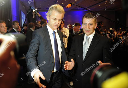 Stock Image of Dutch Right-wing Politician and Islamophobe Geert Wilders (l) is Welcomed by German Christian Democrats Representative Rene Stadtkewitz (r) As He Arrives For a Speech in Berlin Germany 02 October 2010 Geert Wilders who Has Agreed to Support the First Minority Government in the Netherlands Since World War Ii Will Go on Trial in an Amsterdam Court Next Week For Inciting Hatred and Insulting Muslims Germany Berlin