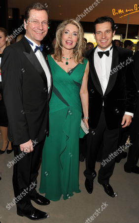 German Foreign Minister Guido Westerwelle (l) His Partner Michael Mronz (r) and Begum Inaara Aga Khan (c) Attend the 17th Annual Opera Charity Gala For the German Aids Foundation at the German Opera House in Berlin Germany 06 November 2010 Germany Berlin