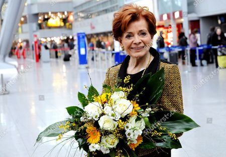 Swiss Singer Lys Assia Winner of the First Eurovision Song Contest in 1956 Poses with a Cake at Duesseldorf Airport Germany 18 March 2011 Assia Talked About Her Eurovision Song Contest Experience During a Press Conference with the Mayor of Duesseldorf Elbers Germany Duesseldorf