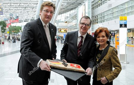 The First Mayor of Duesseldorf Dirk Elbers (l-r) Spokesman of the Airport Management Christoph Blume and Swiss Singer Lys Assia Winner of the First Eurovision Song Contest in 1956 Pose with a Cake at Duesseldorf Airport Germany 18 March 2011 Assia Talked About Her Eurovision Song Contest Experience During a Press Conference with the Mayor of Duesseldorf Elbers Germany Duesseldorf