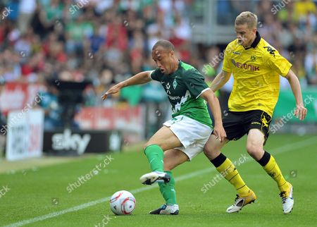 Bremen's Mikael Silvestre (l) Vies For the Ball with Dortmund's Sven Bender (r) During the German Bundesliga Soccer Match Between Werder Bremen and Borussia Dortmund in Bremen Germany 07 May 2011 (attention: Embargo Conditions! the Dfl Permits the Further Utilisation of the Pictures in Iptv Mobile Services and Other New Technologies Only No Earlier Than Two Hours After the End of the Match the Publication and Further Utilisation in the Internet During the Match is Restricted to Six Pictures Per Match Only ) Germany Bremen