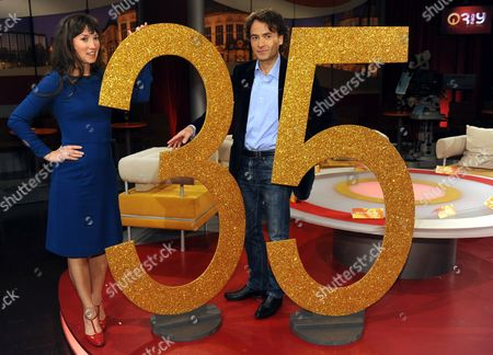 A Picture Dated 09 October 2009 Shows Charlotte Roche (l) and Giovanni Di Lorenzo the Hosts of the 'Longest-serving' Talk Show on German Television '3nach9' by Radio Bremen Before the Start of Its Live Broadcast Presenting the 'Golden 35 ' in Bremen Germany '3nach9' Celebrates Its 35th Anniversary on 06 November Germany Bremen