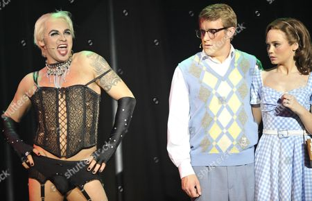 Actors Rob Fowler As Frank'n'furter (l) John Hawkins (c) As Brad and Daisy Wood-davis As Janet Perform During a Dress Rehearsal For the 'Rocky Horror Show' in Cologne Germany 22 June 2011 the Musical Will Premiere on 22 June 2011 and Stays in Cologne Until 10 July 2011 Germany Cologne