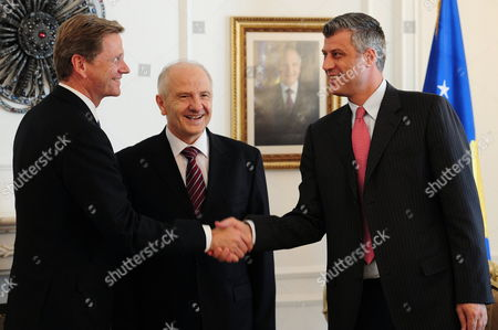 (l-r) German Foreign Minister Guido Westerwelle President of Kosovo Fatmir Sejdiu and Prime Minister of Kosovo Hashim Thaci Shake Hands at the Parliamentary Building in Pristina Kosovo 27 August 2010 After Croatia Serbia and Bosnia Kosovo is Westerwelle's Last Station on a Three-day Trip to the Balkans Serbia and Montenegro Pristina