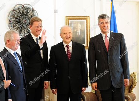 (l-r) Kosovo's Foreign Minister Skender Hyseni German Foreign Minister Guido Westerwelle President of Kosovo Fatmir Sejdiu and Prime Mionister of Kosovo Hashim Thaci Pose For a Picture at the Parliamentary Building in Pristina Kosovo 27 August 2010 After Croatia Serbia and Bosnia Kosovo is Westerwelle's Last Station on a Three-day Trip to the Balkans Serbia and Montenegro Pristina