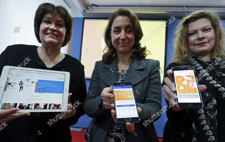 (L-R) President Group Corporate Responsibility of Deutsche Telekom, Birgit Klesper, German Minister of State and Commissioner for Immigration, Refugees and Integration, Aydan Ozoguz, and the member of the New German Media Professional Association (Neue Deutsche Medienmacher), Konstantina Vassilou-Enz, hold mobile devices with the website of 'Handbookgermany.de' during the presentation of the new web portal for refugees in Germany, in Berlin, Germany, 01 February 2017. The new site 'Handbookgermany.de' offers information useful to refugees arriving or living in Germany.