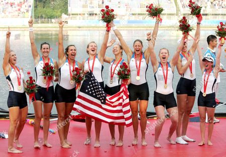 Women's Eight of the Usa with Erin Cafaro Lindsay Shoop Anna Goodale Elle Logan Anne Cummins Susan Francia Caroline Lind Caryn Davies and Mary Whipple Celebrate Their Gold Medal During the Medals Ceremony at the Shunyi Olympic Rowing Park in Beijing 17 August 2008 China Beijing