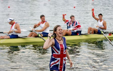 A Young Woman Comes out of the Water where She Celebrate the Men's Four with Tom James Steve Williams Pete Reed and Andrew Hodge Triggs From Great Britain After They Won the Gold Medal at the Shunyi Olympic Rowing Park in Beijing 16 August 2008 China Beijing