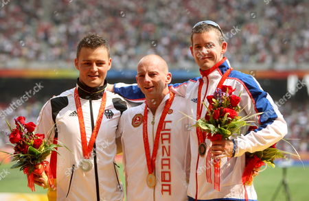 Canada's Earle Connor (c) Germany's Heinrich Popow (l) and John Mcfall of Great Britain (r) Celebrate at the End of the Men's 100m - T42 Final During the Beijing 2008 Paralympic Games China 14 September 2008 Connor Won the Race with a New Paralympic Record of 12 32 Seconds Ahead of Popow who Finished Second with Mcfall in Third China Beijing