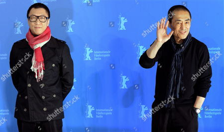 Stock Image of Chinese Director Zhang Yimou (r) and Chinese Actor Sun Honglei (l) Attend the Photocall of the Movie 'A Woman a Gun and a Noodle Shop' (san Qiang Pai an Jing Qi) During the 60th Berlin International Film Festival in Berlin Germany 14 February 2010 the Movie is Presented in Competition at the Berlinale 2010 Running Until 21 February Germany Berlin