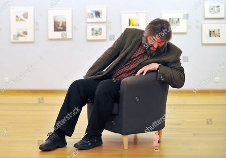 British Cartoonist Steve Bell Poses with a Figurine Representing Britain's Queen Elizabeth Ii in His Exhibition at the German Museum For Caricature and Draughtsmanship in Hanover Germany 11 February 2011 His Exhibbition is on Display Until 15 May Germany Hanover