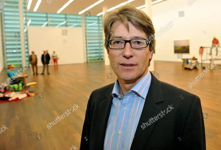 The New Director of the Museum Frieder Burda in Baden-baden Ludger Huennekens Poses For a Photograph in the Large Exhibition Hall of the Museum Frieder Burda in Baden-baden Germany 24 November 2010 in the Background Works by the Two American Artists Duane Hanson (1925 1996) and Gregory Crewdson (born in 1962) Are Part of an Exhibition Entitled Duane Hanson / Gregory Crewdson Uncanny Realities That Runs From 27 November 2010 to 06 March 2011 Germany Baden-baden