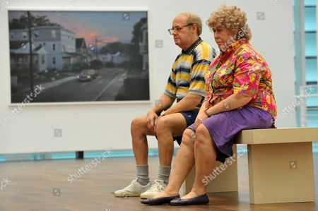 A View of a Pair of Life-size Figures 'Old Couple on a Bench' by Us Artist Duane Hanson in the Large Exhibition Hall of the Museum Frieder Burda in Baden-baden Germany 24 November 2010 in the Background a Photograph by Us Photographer Gregory Crewdson Both Works by the Two American Artists Duane Hanson (1925 1996) and Gregory Crewdson (born in 1962) Are Part of an Exhibition Entitled Duane Hanson / Gregory Crewdson Uncanny Realities That Runs From 27 November 2010 to 06 March 2011 Germany Baden-baden