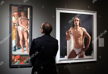 A Man Looks at a Painting (l) Entitled Ecco Homo by Bartholomaeus Bruyn Senior and a Photography (r) Entitled Self Portrait #25 by Jack Pierson at the Wallraf-richartz Museum in Cologne Germany 16 September 2010 the Artworks Are Part of an Exhibition Entitled Do Or Die? the Human Condition in Painting and Photography That Opens to the Public From 17 September 2010 Until 09 January 2011 Germany Cologne