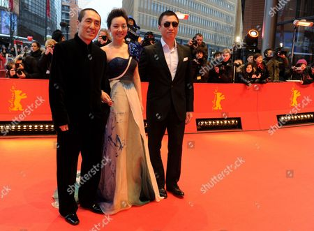 Stock Picture of (l-r) Chinese Director Zhang Yimou Actress Ni Yan and Actor Sun Honglei Arrive at the Premiere of the Film 'A Woman a Gun and a Noodle Shop' (san Qiang Pai an Jing Qi) at the 60th Berlin International Film Festival in Berlin Germany 14 February 2010 the Movie is Presented in Competition at the Berlinale 2010 Running Until 21 February Germany Berlin