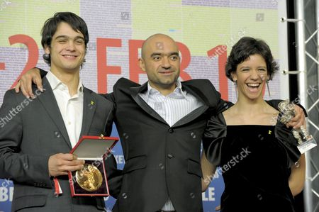 Romanian Director Florin Serban (c) Poses with the Silver Bear - the Jury Grand Prix - For the Movie 'If i Want to Whistle i Whistle' Next to Romanian Actress Ada Condeescu (r) and Romanian Actor George Pistereanu (l) with Their Alfred Bauer Prize For the Film 'If i Want to Whistle i Whistle' During the Press Conference After the Closing Ceremony of the 60th Berlinale International Film Festival in Berlin Germany 20 February 2010 Up to 400 Films Are Shown Every Year As Part of the Berlinale's Public Programme the Berlinale is Divided Into Different Sections Each with Its Own Unique Profile Germany Berlin