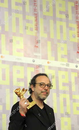 Turkish Director Hasan Semih Kaplanoglu Poses with the Golden Bear For the Best Film For the Movie 'Honey' During the Press Conference After the Closing Ceremony of the 60th Berlinale International Film Festival in Berlin Germany 20 February 2010 Up to 400 Films Are Shown Every Year As Part of the Berlinale's Public Programme the Berlinale is Divided Into Different Sections Each with Its Own Unique Profile Germany Berlin
