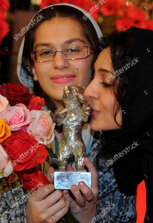 Iranian Actresses Sarina Farhadi (l) and Sareh Bayat (r) Pose with the 'Silver Bear' Award For Best Actress in the Film 'Nader and Simin a Separation' ('jodaeiye Nader Az Simin') After the Awarding Ceremony at the 61st Berlinale International Film Festival in Berlin Germany on 19 February 2011 Iranian Director Asghar Farhadi's Movie 'Jodaeiye Nader Az Simin' (nader and Simin a Separation) Scooped Up a String of Top Prizes at the Berlin Film Festival on 19 February Including the Berlinale's Prestigious 'Golden Bear' For Best Motion Picture Germany Berlin