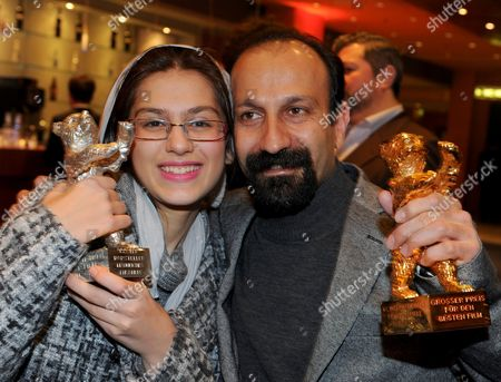 Iranian Director Asghar Farhadi (r)áand Actress Sarina Farhadi (l) Hold Their 'Golden Bear' Awards For Best Movie and 'Silver Bear' For Best Actress After the Awarding Ceremony at the 61st Berlinale International Film Festival in Berlin Germany on 19 February 2011 Evening Iranian Director Asghar Farhadi's Movie 'Jodaeiye Nader Az Simin' (nader and Simin a Separation) Scooped Up a String of Top Prizes at the Berlin Film Festival on 19 February Including the Berlinale's Prestigious 'Golden Bear' For Best Motion Picture Germany Berlin