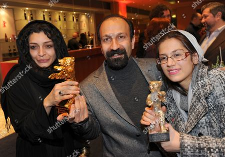 Iranian Director Asghar Farhadi (c)áand Actresses Sareh Bayat (l) and Sarina Farhadi (r) Hold Their 'Golden Bear' For Best Movie and 'Silver Bear' For Best Actresses Awards After the Awarding Ceremony at the 61st Berlinale International Film Festival in Berlin Germany on 19 February 2011 Evening Iranian Director Asghar Farhadi's Movie 'Jodaeiye Nader Az Simin' (nader and Simin a Separation) Scooped Up a String of Top Prizes at the Berlin Film Festival on 19 February Including the Berlinale's Prestigious 'Golden Bear' For Best Motion Picture Germany Berlin