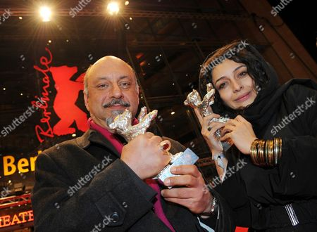 Iranian Actors Babak Karimi (l) and Sareh Bayat Pose with Their 'Silver Bear' Awards For the Film 'Nader and Simin a Separation' ('jodaeiye Nader Az Simin') After the Awarding Ceremony at the 61st Berlinale International Film Festival in Berlin Germany on 19 February 2011 Evening Iranian Director Asghar Farhadi's Movie 'Jodaeiye Nader Az Simin' (nader and Simin a Separation) Scooped Up a String of Top Prizes at the Berlin Film Festival on 19 February Including the Berlinale's Prestigious 'Golden Bear' For Best Motion Picture Germany Berlin