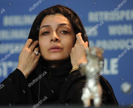 Iranian Actress Sareh Bayat Gestures Behind the Award For Best Actress (silver Bear) She Received For the Film 'Nader and Simin a Separation' ('jodaeiye Nader Az Simin') During the Press Conference After the Closing Ceremony of the 61st Berlin International Film Festival in Berlin Germany 19 February 2011 a Total of 16 Films Are in the Running For the Top Prizes Which Will Be Awarded by a International Jury About 400 Films Are Shown Every Year As Part of the Berlinale's Public Programme Germany Berlin