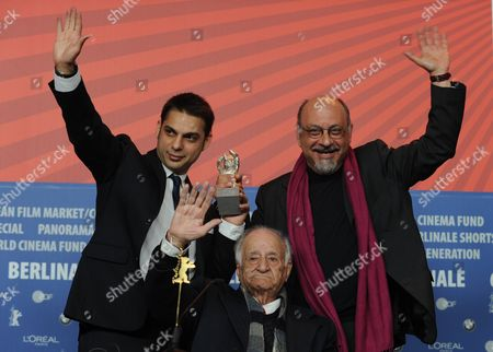 Stock Picture of Actors Peyman Moadi (l-r) Ali Asghar Shahbazi and Babak Karimi Pose with the Silver Bear Award They Received For the Film 'Nader and Simin a Separation' ('jodaeiye Nader Az Simin') During the Press Conference After the Closing Ceremony of the 61st Berlin International Film Festival in Berlin Germany 19 February 2011 a Total of 16 Films Are in the Running For the Top Prizes Which Will Be Awarded by a International Jury About 400 Films Are Shown Every Year As Part of the Berlinale's Public Programme Germany Berlin