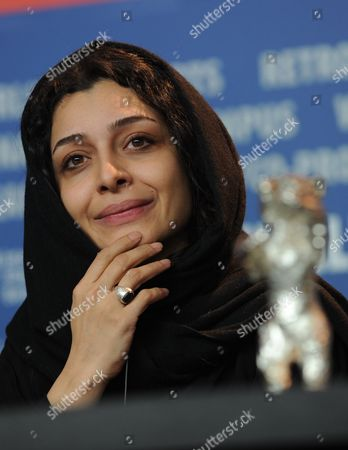 Iranian Actress Sareh Bayat Smiles Behind the 'Silver Bear' Award For Best Actress She Received For Acting in the Film 'Nader and Simin a Separation' ('jodaeiye Nader Az Simin') During the Press Conference After the Closing Ceremony of the 61st Berlin International Film Festival in Berlin Germany 19 February 2011 a Total of 16 Films Were in the Competition Iranian Director Asghar Farhadi's Movie 'Jodaeiye Nader Az Simin' (nader and Simin a Separation) Won the Berlinale's Prestigious 'Golden Bear' For Best Motion Picture Germany Berlin