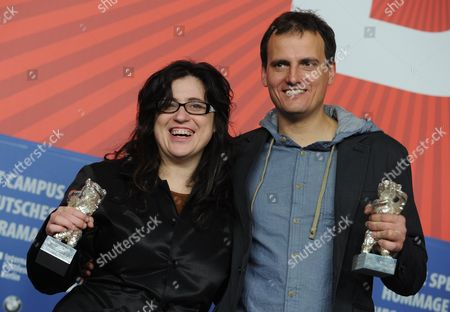 Stock Photo of Mexican Director Paula Markovitch (l) and Cinematographer Wojciech Staron Pose with the 'Silver Bear' Award For an Outstanding Artistic Achievement in the Categories Camera For Their Film 'The Prize' ('el Premio') During the Press Conference After the Closing Ceremony of the 61st Berlin International Film Festival in Berlin Germany 19 February 2011 a Total of 16 Films Were in the Competition Iranian Director Asghar Farhadi's Movie 'Jodaeiye Nader Az Simin' (nader and Simin a Separation) Won the Berlinale's Prestigious 'Golden Bear' For Best Motion Picture Germany Berlin