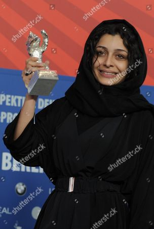 Iranian Actress Sareh Bayat Poses with the Award For Best Actress (silver Bear) She Received For the Film 'Nader and Simin a Separation' ('jodaeiye Nader Az Simin') During the Press Conference After the Closing Ceremony of the 61st Berlin International Film Festival in Berlin Germany 19 February 2011 a Total of 16 Films Are in the Running For the Top Prizes Which Will Be Awarded by a International Jury About 400 Films Are Shown Every Year As Part of the Berlinale's Public Programme Germany Berlin