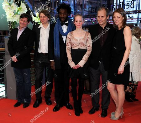 (l-r) Dutch Actor Pierre Bokma Actor Sava Lolov French Actor Jean-christophe Folly Actress Maria Elise Miller French Actor Hippolyte Girardot and German Actress Jenny Schily Arrive For the Premiere of the Film 'Schlafkrankheit' (sleeping Sickness) During the 61st Berlin International Film Festival in Berlin Germany 12 February 2011 the Film by Ulrich Koehler is Presented in Competition at the 61st Berlinale That Runs From 10 to 20 February Germany Berlin