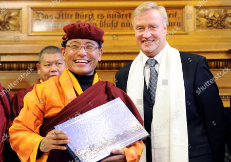 Spiritual Head of Tibetan Drukpa-order the 12th Gyalwang Drukpa (l) is Greeted by Hamburg's Mayor Ole Von Beust (cdu) (r) in Hamburg Germany 05 January 2010 in His Hand the Guest Holds a Pictorial Which He Recieved Earlier Afterwards the Student of the Dalai Lama Wanted to Sign the City's Golden Book the Drupka-order is One of the Tibetan Buddhist Schools and a State Religion in Bhutan Worldwide About Four Million People Belong to This Order Germany Hamburg