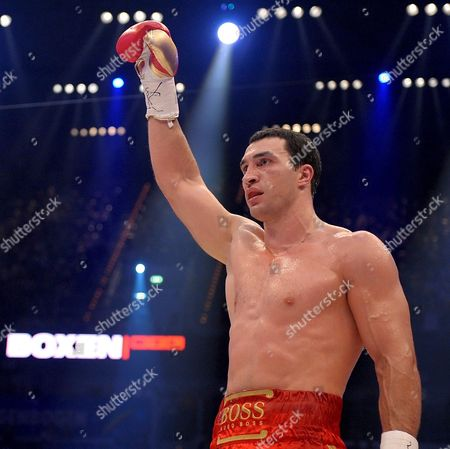 Ukrainian World Champion Vladimir Klitschko (l) Celebrates After His Victory Over Us Boxer Hasim Rahman (not in the Picture) During Their Ibo and Wbo Heavyweight Titles Bout at Sap Arena in Mannheim Germany on 13 December 2008 Germany Manheim