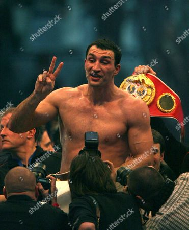 Ukrainian World Champion Vladimir Klitschko (c) Celebrates After His Victory Over Us Boxer Hasim Rahman (not in the Picture) During Their Ibo and Wbo Heavyweight Titles Bout at Sap Arena in Mannheim Germany on 13 December 2008 Klitschko Beat His Opponent Rahman with a Knock-out in the Seventh Round Germany Manheim