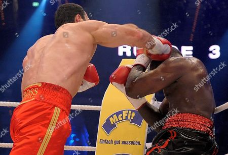 Ukrainian World Champion Vladimir Klitschko (l) Exchanges Punches with Us Boxer Hasim Rahman During Their Ibo and Wbo Heavyweight Titles Bout at Sap Arena in Mannheim Germany on 13 December 2008 Klitschko Beat His Opponent Rahman with a Knock-out in the Seventh Round Germany Manheim