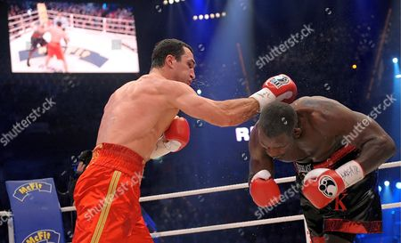 Ukrainian World Champion Vladimir Klitschko (l) Hits Us Boxer Hasim Rahman During Their Ibo and Wbo Heavyweight Titles Bout at Sap Arena in Mannheim Germany on 13 December 2008 Klitschko Beat His Opponent Rahman with a Knock-out in the Seventh Round Germany Manheim
